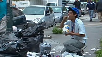 Poverty - A Venezuelan eating from garbage during the crisis in Bolivarian Venezuela