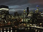 View of Melbourne CBD from the Hilton South Wharf. The MEL heliport is immediately in front of the hotel on the riverfront. (27298128925).jpg