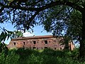 View through Foliage of Shell-Scarred Barracks - Brest Fortress - Brest - Belarus (27350133341).jpg