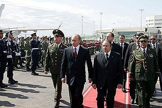 Abdelaziz Bouteflika - Bouteflika with then President of Russia Vladimir Putin at Houari Boumedienne Airport in Algiers on 10 March 2006.