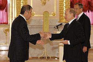 Abdulmajid Dostiev - Vladimir Putin (right) greets Abdulmajid Dostiev (left)