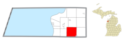 Location within Benzie County (red) and an administered portion of the Thompsonville village (pink)