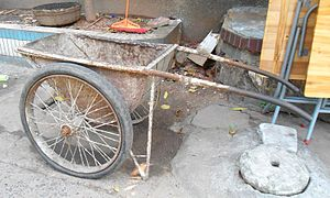 Wheelbarrow - A metal wheel barrow in Haikou City, Hainan Province, China