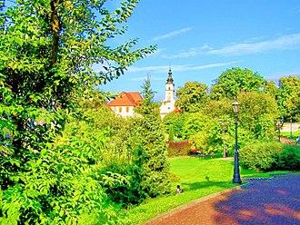 Wieliczka - Park in Wieliczka with church in background