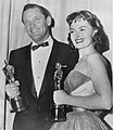William Holden and Donna Reed hold their gold-plated Oscars, 1954.jpg