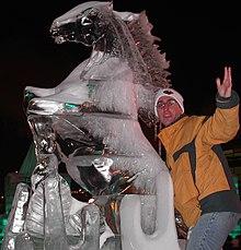 9e0b2f51b37 Man examines a Winter Carnival ice sculpture.