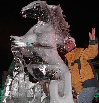 Saint Paul Winter Carnival - Man examines a Winter Carnival ice sculpture.