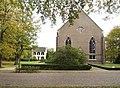 Zicht op de voorzijde met entree en pastorie links - Veenhuizen - 20411602 - RCE.jpg