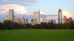 Zilker Park's football pitch in front of Austin's skyline