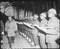 """Lt. Gen. Joseph T. McNarney, Deputy Supreme Allied Commander, Mediterranean Theater, inspects Honor Guard of MPs during - NARA - 531415.tif"