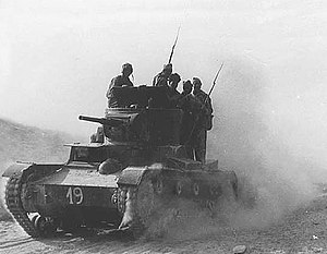 Second Spanish Republic - International Brigadiers volunteered on the side of the Republic. The photo shows members of the XI International Brigade on a tank during the Battle of Belchite (August–September 1937)