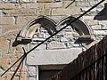 039 Castell de Vallfogona de Riucorb, façana est, restes de finestra geminada gòtica.jpg
