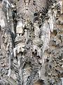 066 Sagrada Família, façana del Naixement, porta de la Fe, àngels trompeters.jpg