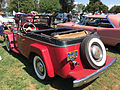 1950 Willys Jeepster 6-cylinder in red and black with open top at 2015 Macungie show 2of4.jpg