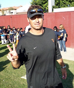"Steve Sarkisian - Sarkisian making USC's traditional ""V-for-victory"" sign after a 2008 fall practice"
