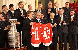 2007–08 Detroit Red Wings season - The 2008 Stanley Cup champion Red Wings present two jerseys to U.S. President George W. Bush.