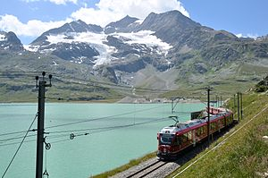 Val Poschiavo - Bernina Express train passing Lago Bianco near Ospizio Bernina station