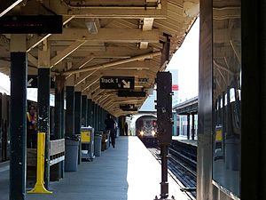 Van Cortlandt Park–242nd Street (IRT Broadway–Seventh Avenue Line) - Looking south from the north end of the tracks, a 1 train enters Track 1. Another 1 train sits at Track 4.