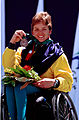 261000 - Athletics wheelchair racing 200m T34 Rebecca Feldman bronze medal podium - 3b - 2000 Sydney medal photo.jpg