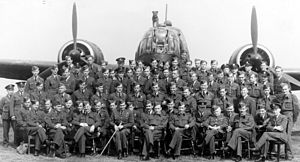 RAF Cammeringham - No. 305 Polish Bomber Squadron posed in front of a Vickers Wellington bomber aircraft in 1942