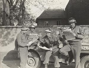 Four MPs take a break along a German road to r...