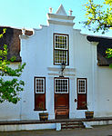 This imposing architectural complex consists of a Cape Dutch house which was erected in about 1815 and a double-storeyed annex which dates back to about 1960. The property is closely associated with two well-known Stellenbosch families, i.e. the Neethlings and Ackermanns.