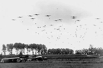 82nd Airborne Division - Men of the 82nd Airborne Division drop near Grave in the Netherlands during Operation Market Garden.