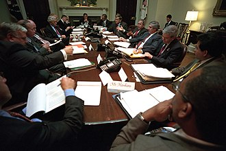 Mitch Daniels - Daniels with President George W. Bush and other advisers in the Roosevelt Room in 2001