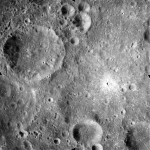 Denning (lunar crater) - Apollo 15 image showing Denning to the upper left. Note the high-albedo crater at right center. NASA photo.