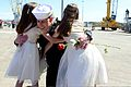 A U.S. Sailor assigned to the aircraft carrier USS John C. Stennis (CVN 74) hugs his daughters during a homecoming ceremony at Naval Station Kitsap in Bremerton, Wash., May 3, 2013 130503-N-KD696-195.jpg