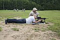 A business leader attending a Marine Corps Executive Forum (MCEF) fires an M27 rifle at a target under the supervision of a U.S. Marine aboard Marine Corps Base Quantico, Va., July 11, 2013 130711-M-MI461-323.jpg