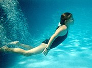 A girl in a swimming pool - underwater