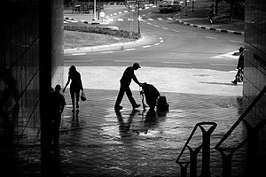 Janitor - A janitor cleaning up the sidewalk