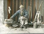 A man in his shoe repair stall (6025232620).jpg