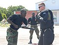 A member of the Ghana Army 2nd Engineer Battalion practices baton techniques on a fellow soldier during a nonlethal force demonstration June 26, 2013, in Accra, Ghana, as part of exercise Western Accord 2013 130626-A-ZZ999-021.jpg