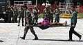 A rescued injured lady on a stretcher being taken for emergency medical treatment in quake hit Nepal.jpg
