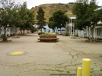 """Heritage Square (Golden, Colorado) - An abandoned area with vacant buildings one block over from """"Main Street""""."""