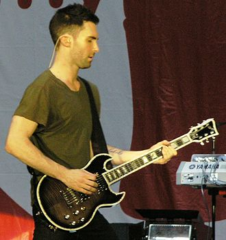 Adam Levine - Levine playing the First Act 222 Guitar, which he helped design