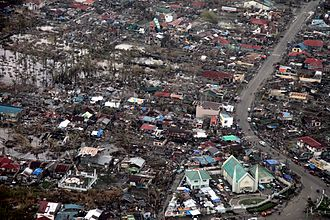 Effects of tropical cyclones - Aerial image of destroyed houses in Tacloban, following Typhoon Haiyan