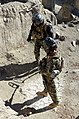 Afghan National Security Forces members with a Paktika village response unit search for improvised explosive devices and weapons caches during a clearing operation Jan. 6, 2014, near Naway Pasanay village 140106-A-ZR634-029.jpg