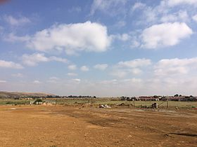 African School of Excellence Tsakane Gauteng school buildings and landscape beyond.JPG