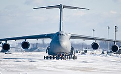 Aircraft maintenance personnel tow a U.S. Air Force C-5M Super Galaxy aircraft at Dover Air Force Base, Del., Jan. 3, 2014 140103-F-BO262-040.jpg