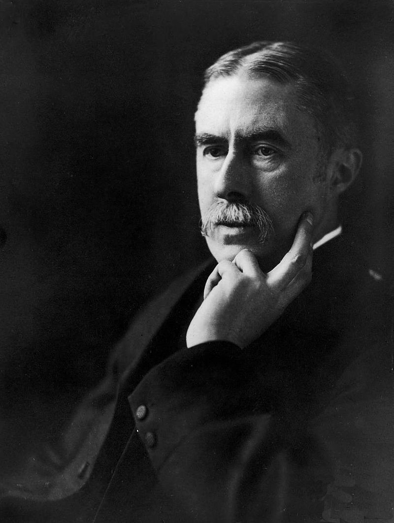 Poet A. E. Housman, with a book - Bryn Mawr College photo