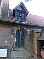 All Saints Theydon Garnon nave south window at west (Nikon L810).jpg