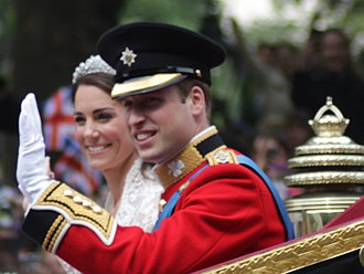 Wedding of Prince William and Catherine Middleton - The Duke and Duchess of Cambridge waving to the crowd at The Mall shortly after the wedding.