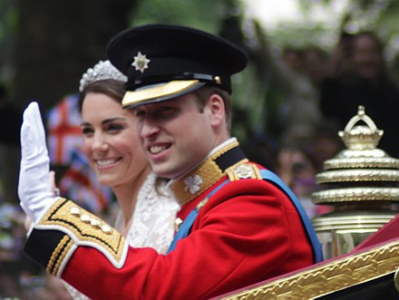 Prince William wearing an Irish Guards Tunic and Forage Cap at his wedding to Kate Middleton All smiles Wedding of Prince William of Wales and Kate Middleton.jpg