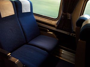 Two reclining seats with blue upholstery
