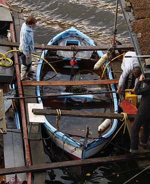 Marine salvage - A house boat dinghy being salvaged in an Amsterdam canal