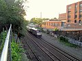 Amtrak Downeaster passing former Somerville Junction station site, July 2015.JPG