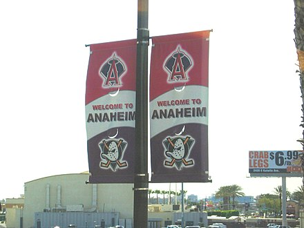 Street banners promoting the Anaheim Ducks and Los Angeles Angels. Anaheim-streetbanners-ducksangels.JPG
